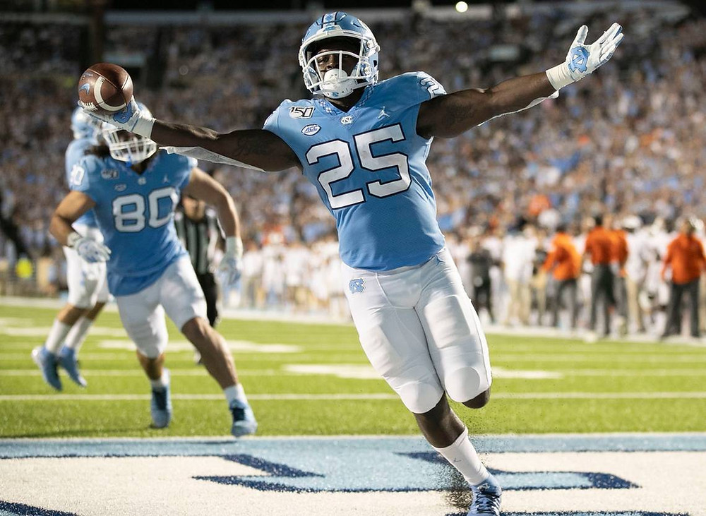 Javonte Williams scores a touchdown against another opponent in one of his many games for UNC Chapel Hill. One of the best running backs in the NCAA and in the 2021 NFL Draft Class.