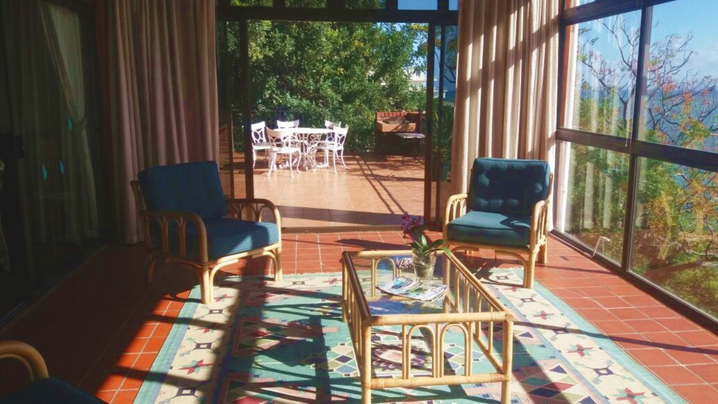 Sunroom opens on to deck with braai facilities