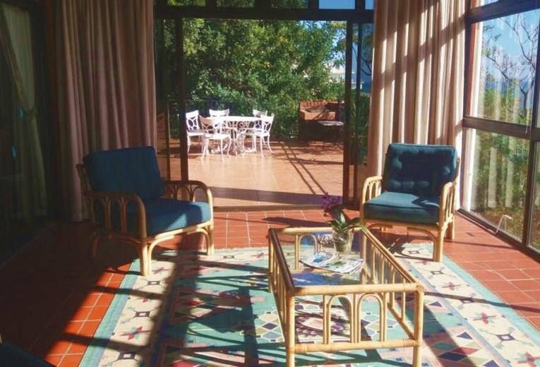 Sunroom opens on to deck with braai facilities