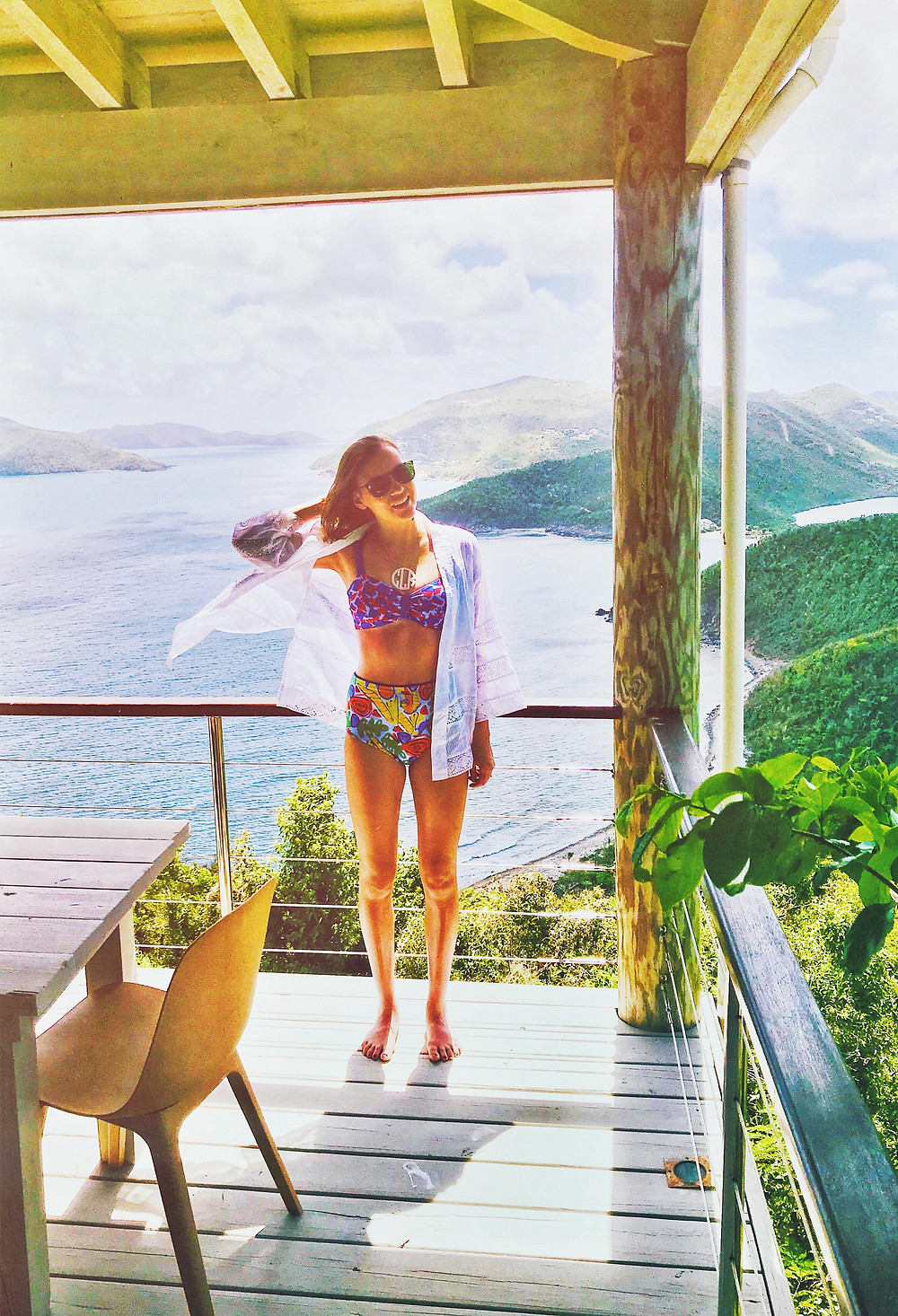 Standing on a porch in Tortola, British Virgin Islands, wearing an Anthropologie high waisted bikini overlooking the Caribbean.