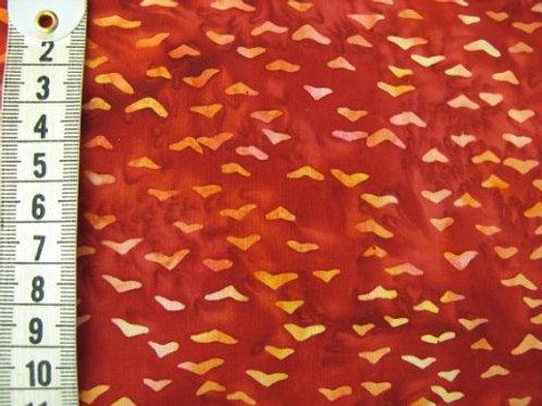 Mørk rød bund med mønster i lyse - gule og orange farver - bali