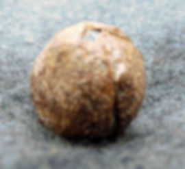 A patched ball for a flintlock Baker Rifle