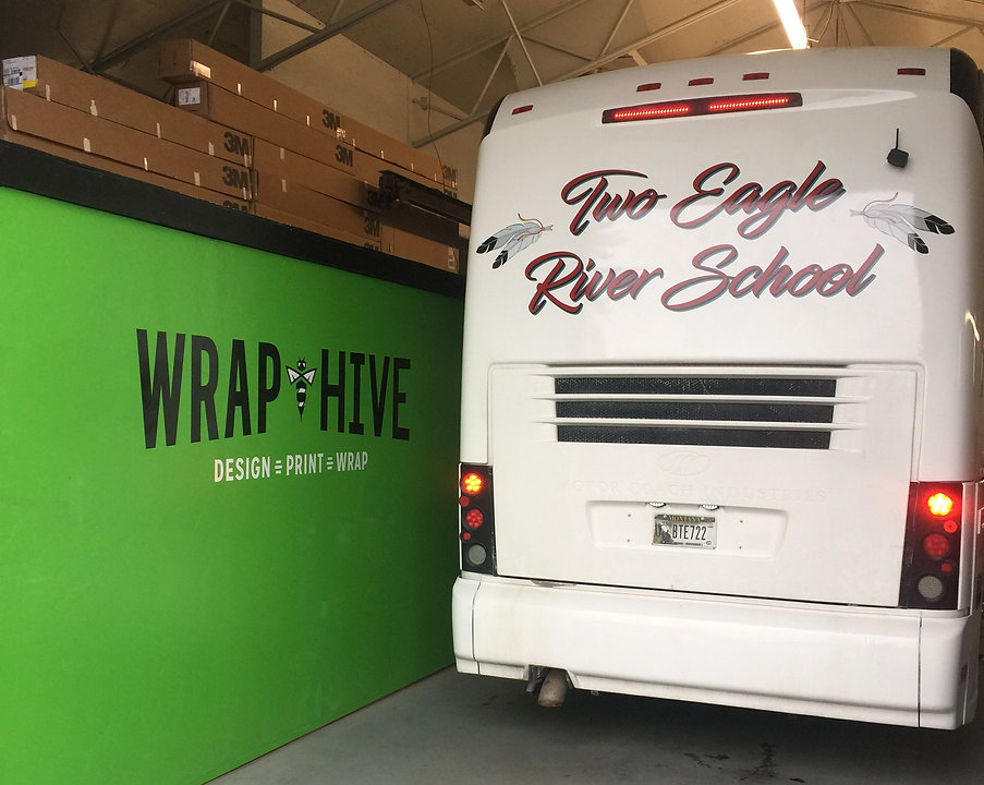 Two Eagle River School bus wrap and graphics by Wrap Hive, Kalispell Montana. Transform your vehicle today with a custm wrap from Wrap Hive!