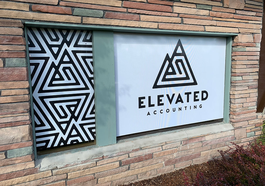 black and white rigid sign with custom repeating pattern for Elevated Accouting. Wrap Hive Kalispell, Montana