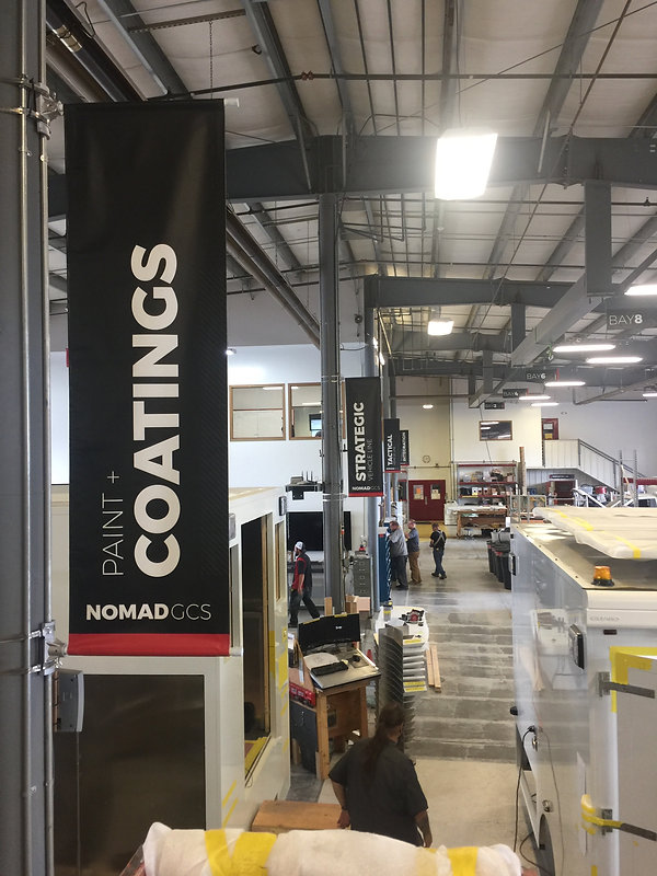 High quality hanging pole mounted pole pocket vinyl banners for Nomad GCS by Wrap Hive