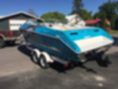 Brigh blue printed wrap fot a Valanti boat in Flathead Valley