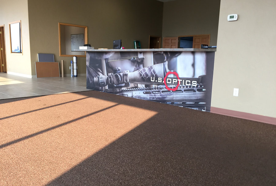 Half wall printed photo wrap for U.S. Optics, by Wrap Hive