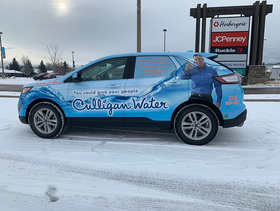 Side view of culligan full wrap Ford Edge. Wrapped by Wrap Hive in Kalispell