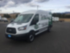 Full sized Ford Transit with partial wrap on back, by Wrap Hive Kalispell
