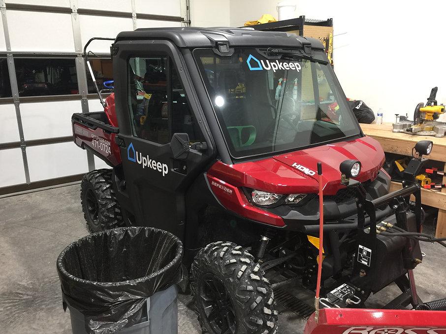 Upkeep logos on a 4 wheeler | Wrap Hive Kalispell