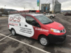 Fleet vehicle wrap by Wrap Hive in Kalispell, MT. Van wrap for Digital Communications Systems in Kalispell, MT.