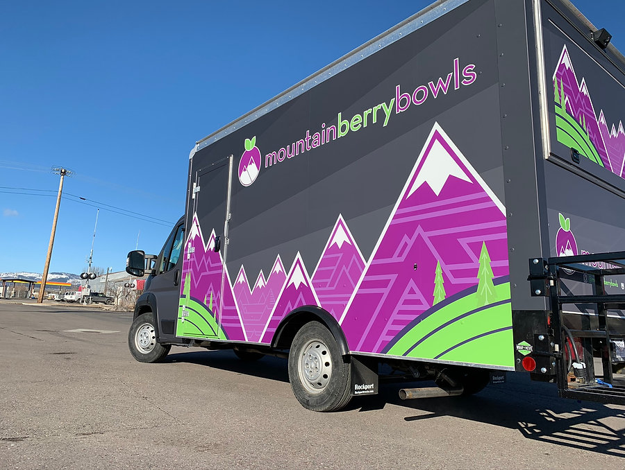 Purple, green, gray full coverage food truck wrap