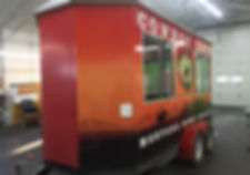 side and front view of Cowboy Cafe food trailer, Coram, MT. Custom designed and installe by Wrap Hive