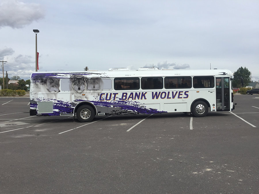 Partial printed wrap on a charter bus