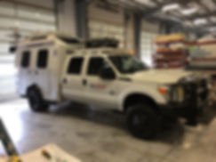 Nomad Whitefish Energy truck with decals by Wrap Hive