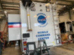 NASA logo decal and text decls on back of Nomad mobile command center