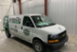 Partial wrap and printed decals on a Cheverolet Express van, wrapped by  Wrap Hive