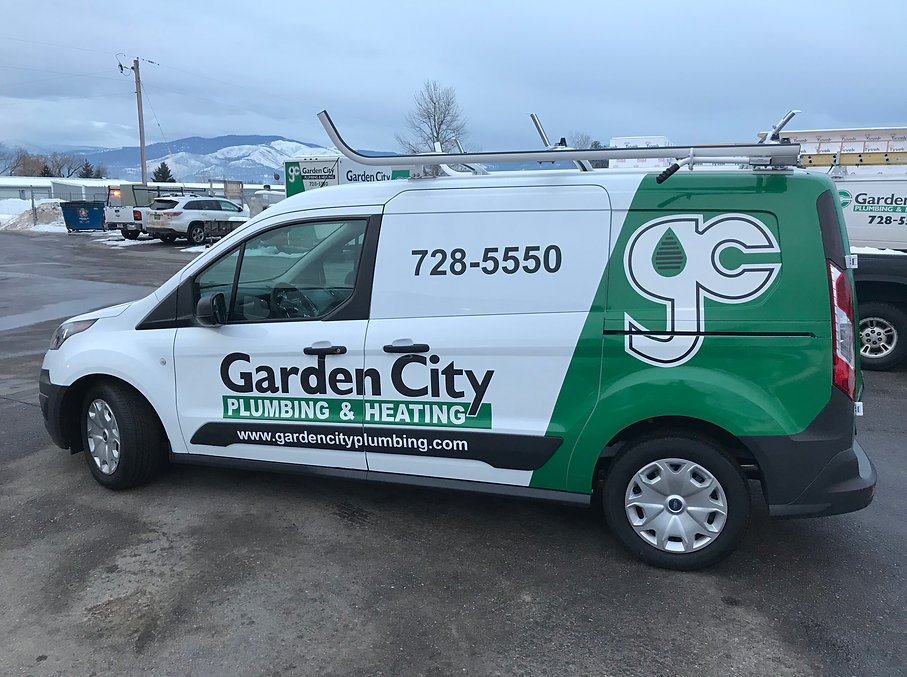 Ford Transit decals and partial wrap for Garden City plumbing and heating, designed and installed by Wrap Hive