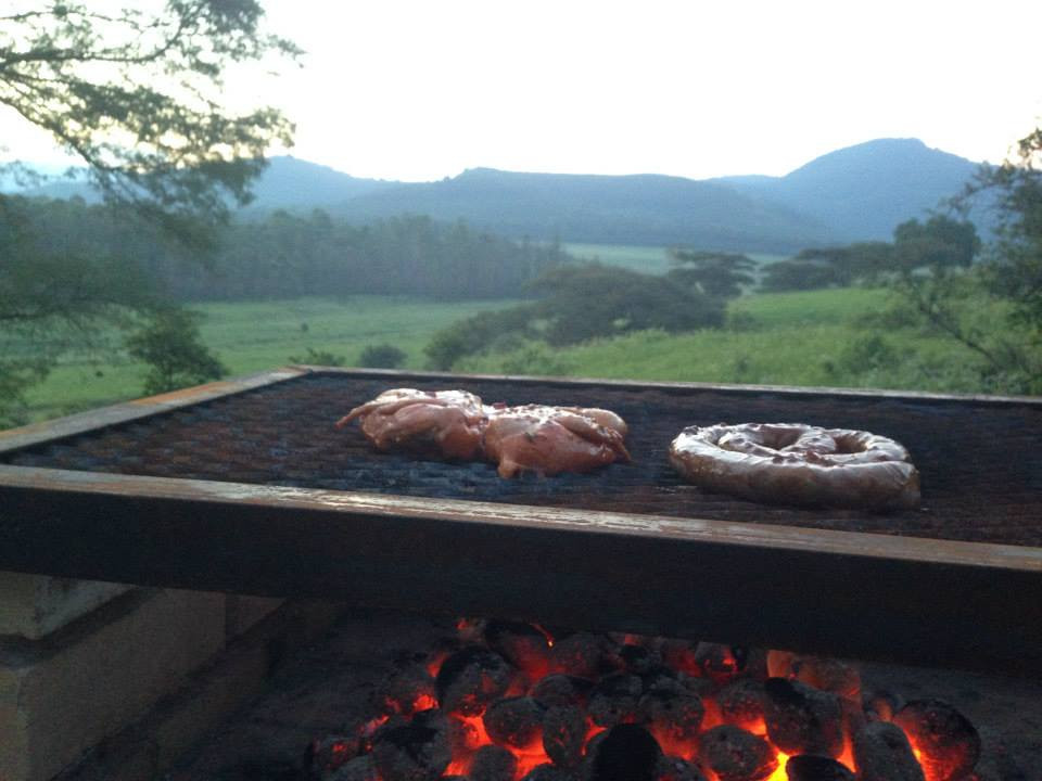 A braai barbecue with chicken and wors overlooking Mlilwane game reserve Swaziland Eswatini
