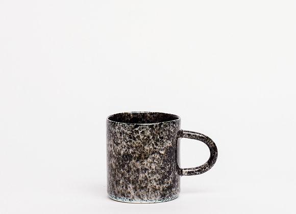 small mug black splatter dense