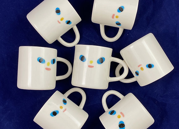 small mug with a face