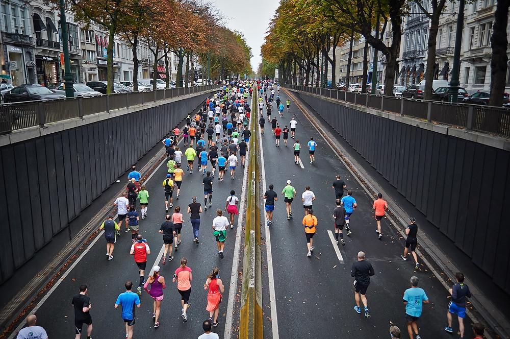 Marathon runners running in the street