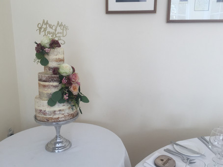 Ivory, pink and burgundy semi-naked cake