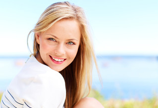 Improving the appearance of your smile with crowns and veneers in Burnham