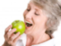 older-woman-eating-apple.jpg