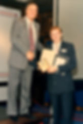 Paul receiving awards from a VP