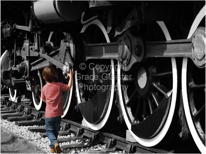 Small Boy Big Wheels by Grace Glaister