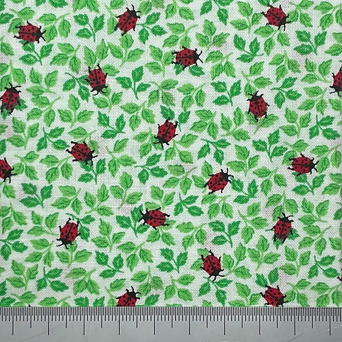 Ladybirds on green leaves cotton print