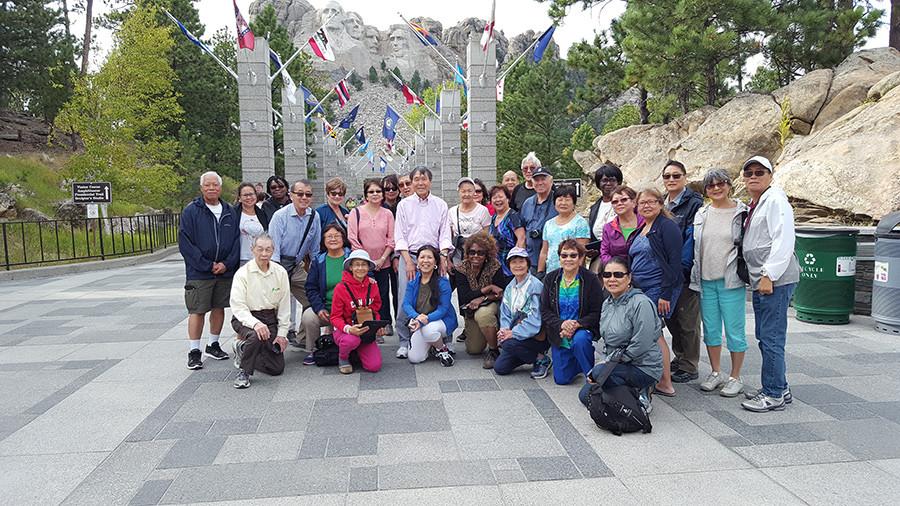 Group at base of Mount Rushmore