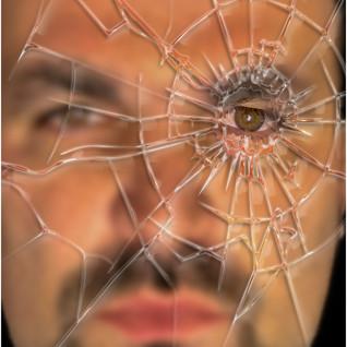 Behind the broken glass