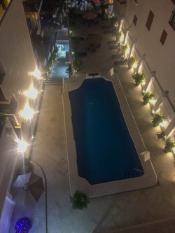 Boana Torre Malibu view of pool at night