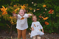 Reese & Ry with leaves.jpg