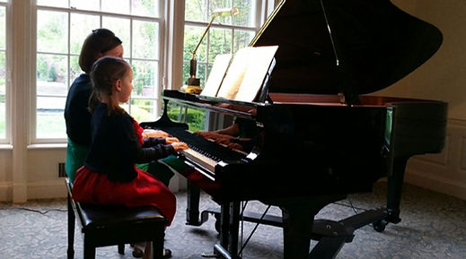 Ana Yoder Coulter piano recital duet with student