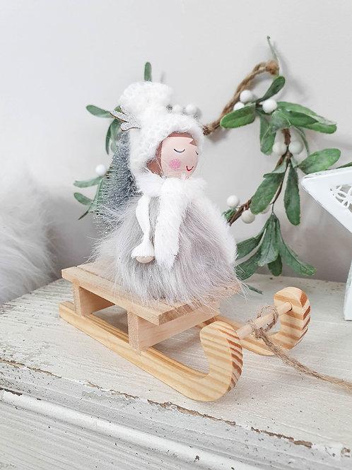 Fluffy Girl Decoration On Sledge