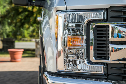 Front headlight of silver Ford F250
