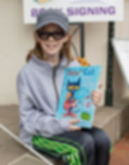 Young blind girl holding book