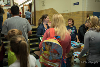 Families heading to auditorium for author presentation