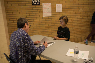 Eric Litwin signing book for excited boy