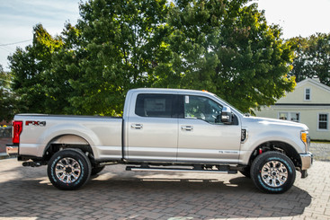 Side view of silver Ford F250