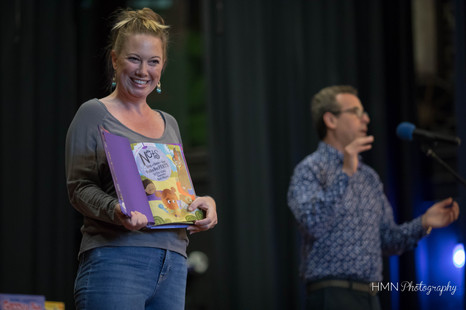 Eric Litwin acting out book, while mother from audience holds book