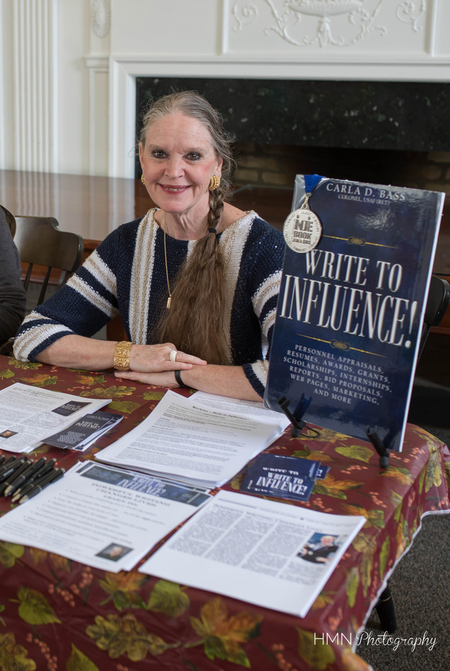 "Visiting author Carla Bass with her book ""Write to Influence!"""