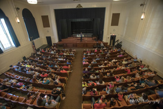 Bird's eye view of packed auditorium
