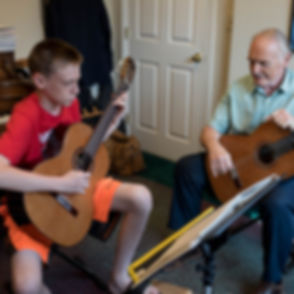 Guitar lesson with student and instructor