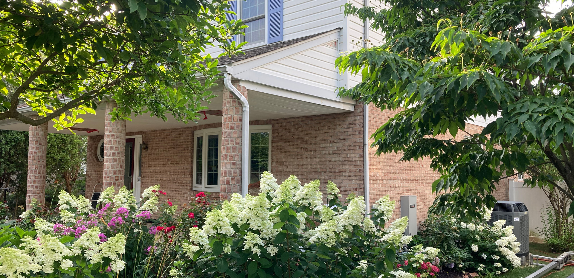 Ridley Park - New vinyl siding, gutters, and shutters.