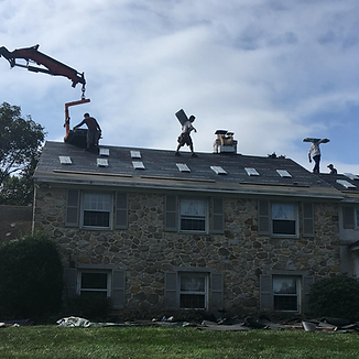 Strath Haven Roofing & Restoration team working on a roof in Broomall, PA