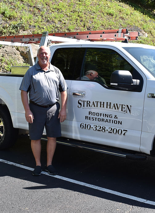 Jim Rothschild owner of Strath Haven Roofing & Restoration next to his work vehicle Villanova PA